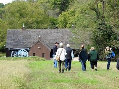 Photo of people walking to barn